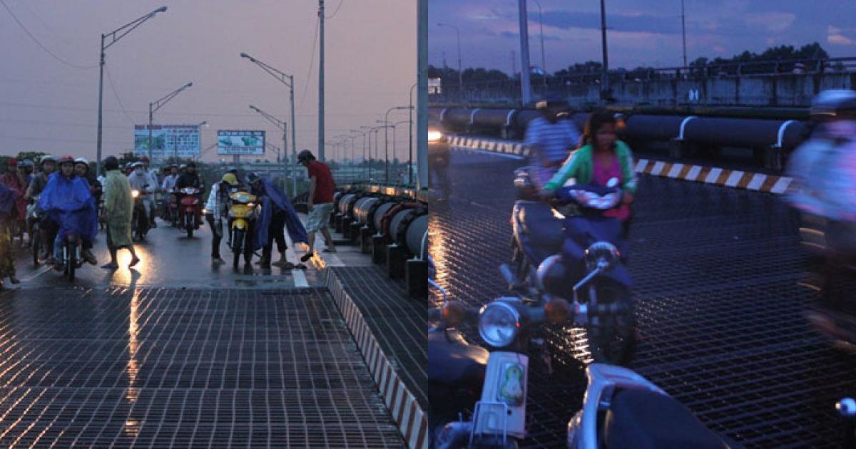 Trời mưa, hàng chục xe té trên tấm lưới sắt trên cầu