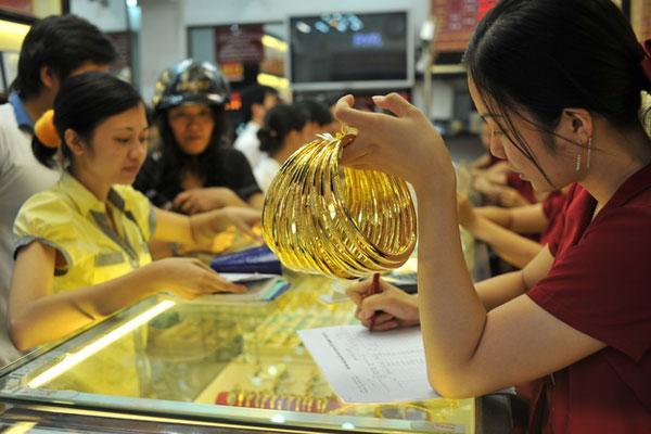 Vàng trong nước tăng chậm, chênh lệch thu hẹp - Hình 1
