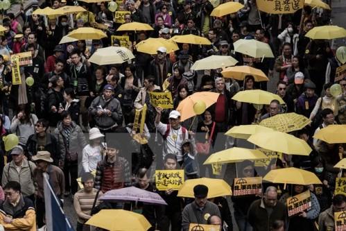 Trung Quốc kiên định áp dụng phổ thông đầu phiếu tại Hong Kong - Hình 1
