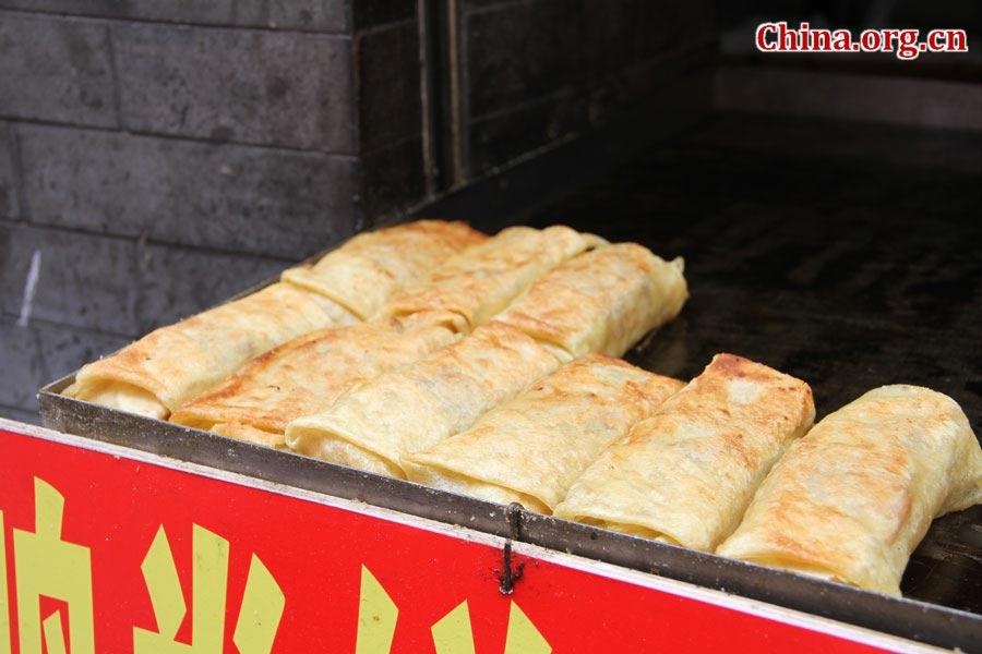 Đến Bắc Kinh nhất định phải dạo phố thử hết những món ăn vặt này - Hình 1