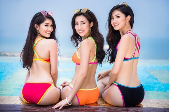 Top 3 Hoa hậu Việt Nam 2016 diện bikini nóng bỏng khoe dáng bên hồ bơi vô cực dát vàng - Hình 1