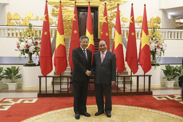 Thủ tướng: Việt Nam coi trọng quan hệ đối tác chiến lược toàn diện với Trung Quốc - Hình 1