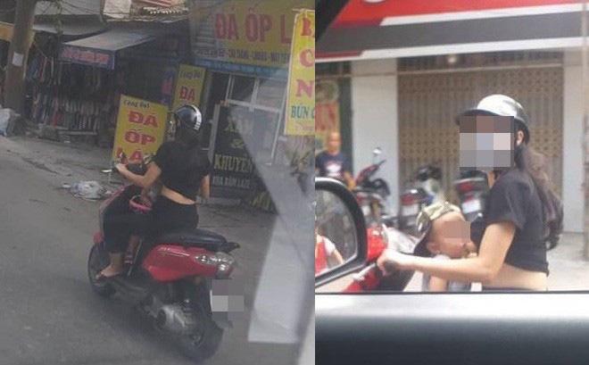 Vừa lái xe vừa cho con trai bú, người phụ nữ khiến người đi đường toát mồ hôi lạnh - Hình 1