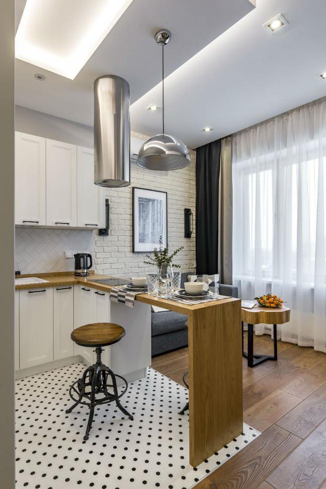 Vỏn vẹn 25m² nhưng căn hộ nhỏ với vẻ ngoài độc đáo vẫn khiến người xem mãn nhãn vì sự kết hợp siêu mượt mà - Hình 2