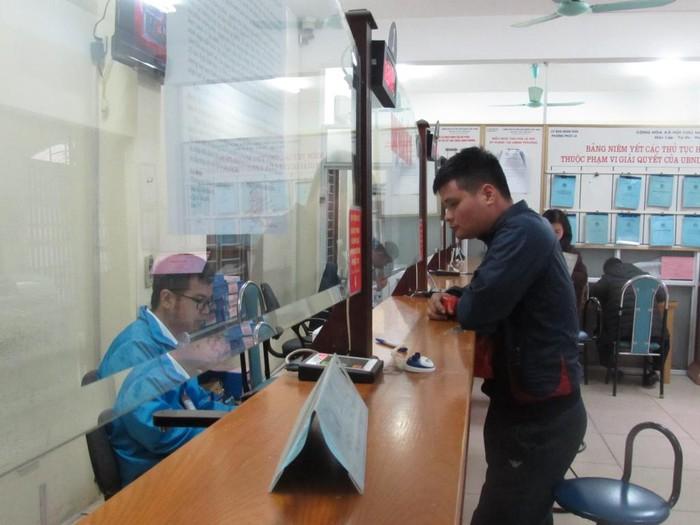Ứng dụng công nghệ thông tin là công cụ thúc đẩy công tác CCHC của Hà Nội - Hình 1
