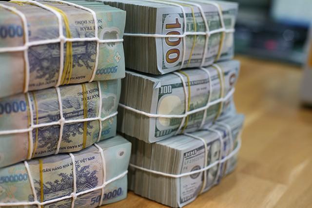 Không có khoản tiền gửi từ Kho bạc, lãi suất vẫn hạ nhiệt - Hình 1