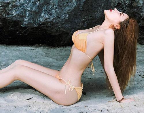 Ngắm thân hình vạn người mê của nữ gymer hot nhất nhì Việt Nam từng lên báo Trung - Hình 7