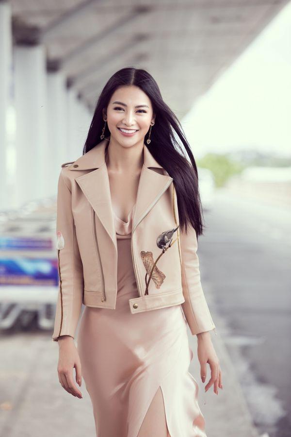 Đi chấm thi Miss Earth Singapore, Hoa hậu Phương Khánh đẹp như thần Vệ Nữ làm náo loạn sân bay - Hình 4
