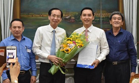 UBND TPHCM có tân Phó Chánh Văn phòng 35 tuổi - Hình 1