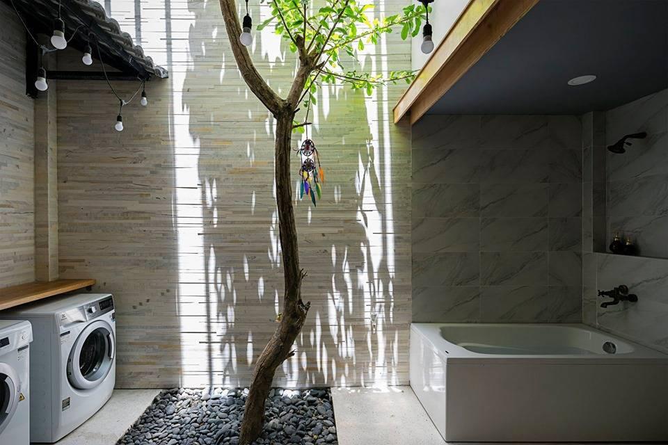Ngôi nhà ống sở hữu thiết kế nhà trong nhà cực độc đáo ở thành phố đáng sống nhất Việt Nam - Hình 25