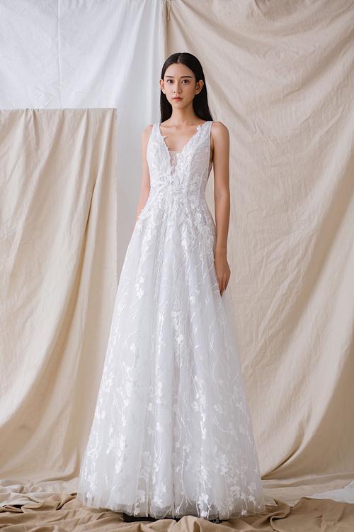 Váy cưới tái hiện câu chuyện tình của cô dâu chú rể - Hình 1