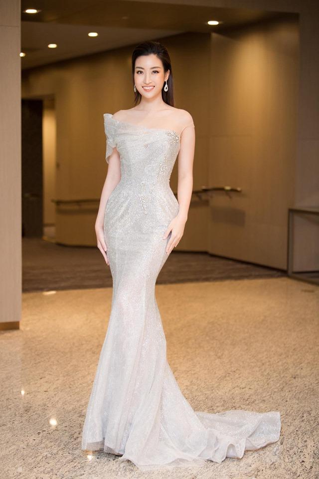 Hoa hậu Đỗ Mỹ Linh mặc đẹp tựa nữ thần, phớt lờ ồn ào bủa vây? - Hình 4