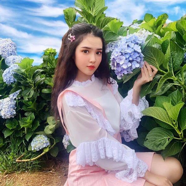 Nữ sinh Đồng Tháp lên báo Trung với loạt ảnh mặc áo dài trắng tôn 3 vòng gợi cảm - Hình 10