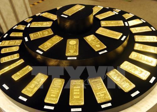 Giá vàng giảm do lợi tức trái phiếu Mỹ tăng và đồng USD mạnh lên - Hình 1