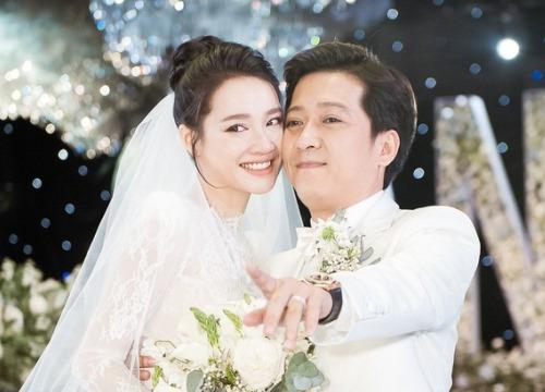 Mặc váy cưới lộng lẫy, Nhã Phương xúc động kỷ niệm một năm chung mái ấm với Trường Giang - Hình 1