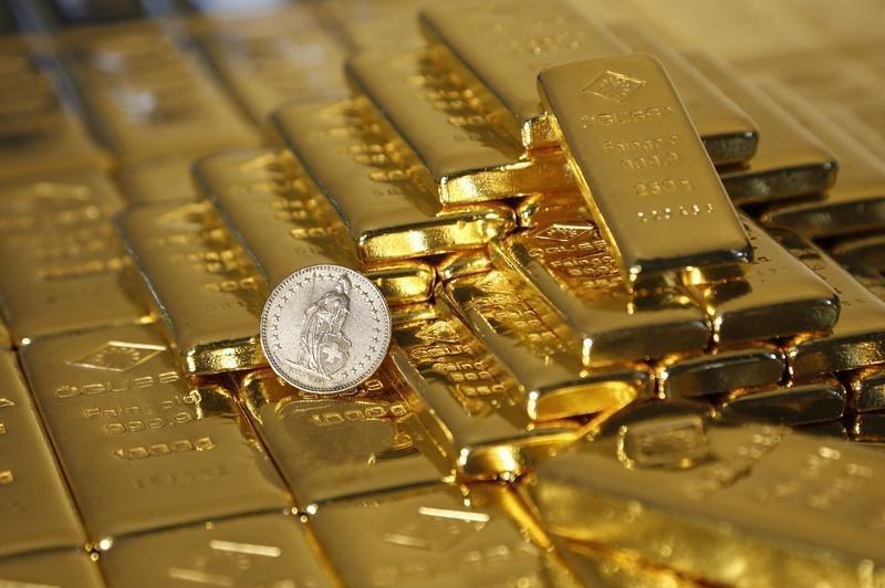 Giá vàng hôm nay 7/1: Nhà đầu tư thi nhau bán chốt lời, giá vẫn rất cao - Hình 1