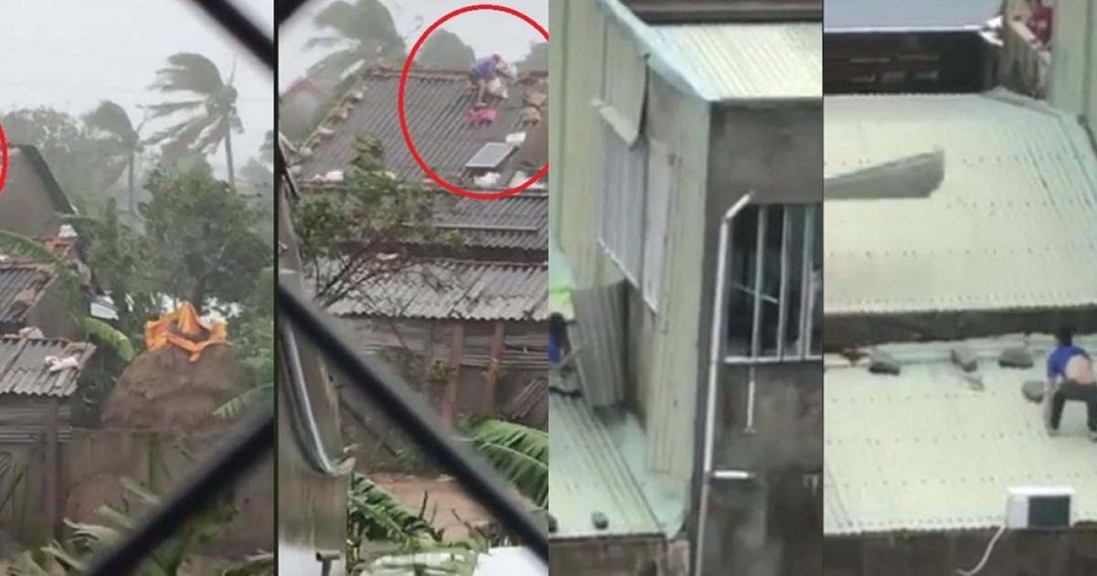Bất chấp mưa gió, người đàn ông liều mình ra ngoài chằng chống nhà cửa