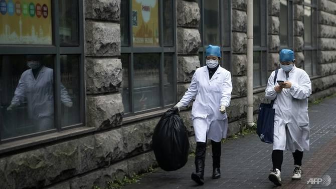 Thành phố sầm uất nhất Trung Quốc rơi vào hôn mê vì virus corona - Hình 1